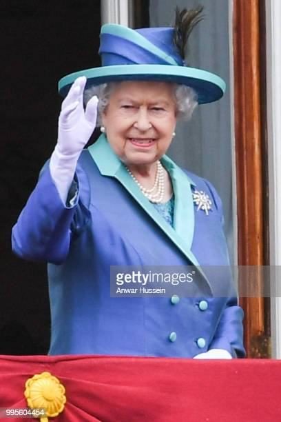 Queen Elizabeth ll stands on the balcony of Buckingham Palace to view a flypast to mark the centenary of the Royal Air Force on July 10 2018 in...