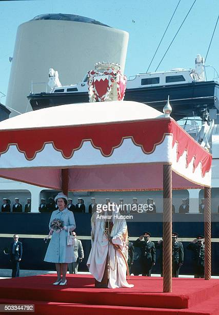 Queen Elizabeth ll stands with the Amir of Bahrain as she arrives on the Royal Yacht Britannia for a tour of the Gulf States on February 14 1979 in...
