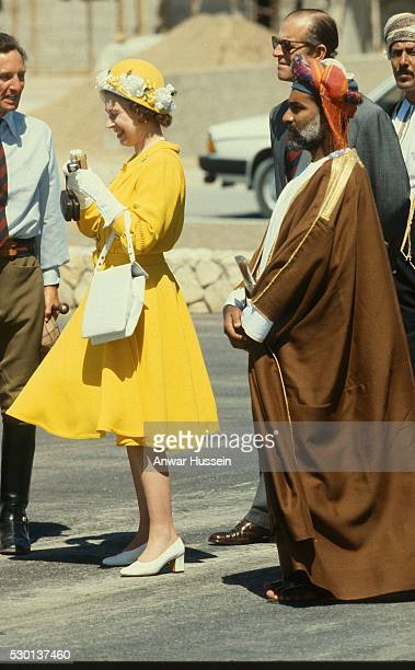Queen Elizabeth ll takes a photograph as she visits Muscat with Sultan Qaboos on February 28 1979 in Muscat Oman