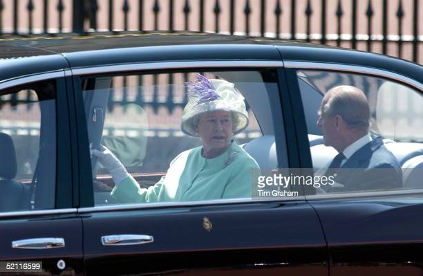 Queen Elizabeth Ll Talking To Husband Prince Philip As They Are Driven In Their New Bentley Car To Meet The President Of The Russian Federation At...