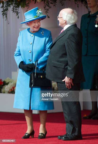 Queen Elizabeth ll talks to the Irish President Michael D Higgins during a ceremonial welcome on April 08 2014 in Windsor England