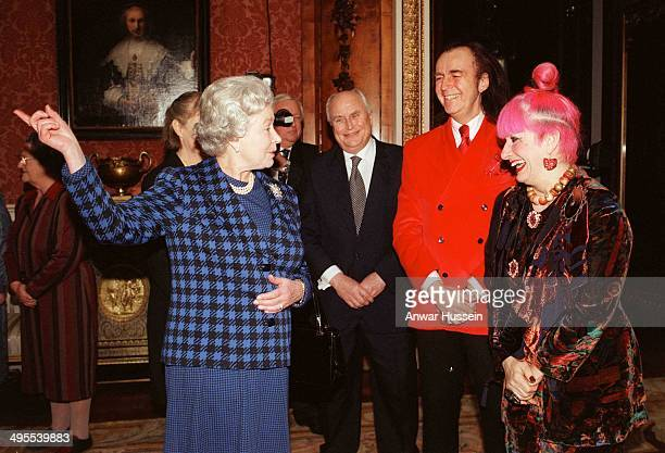 Queen Elizabeth ll talks with celebrity embroiderers Norman Willis David Shilling and fashion designer Zandra Rhodes in the Picture Gallery at...