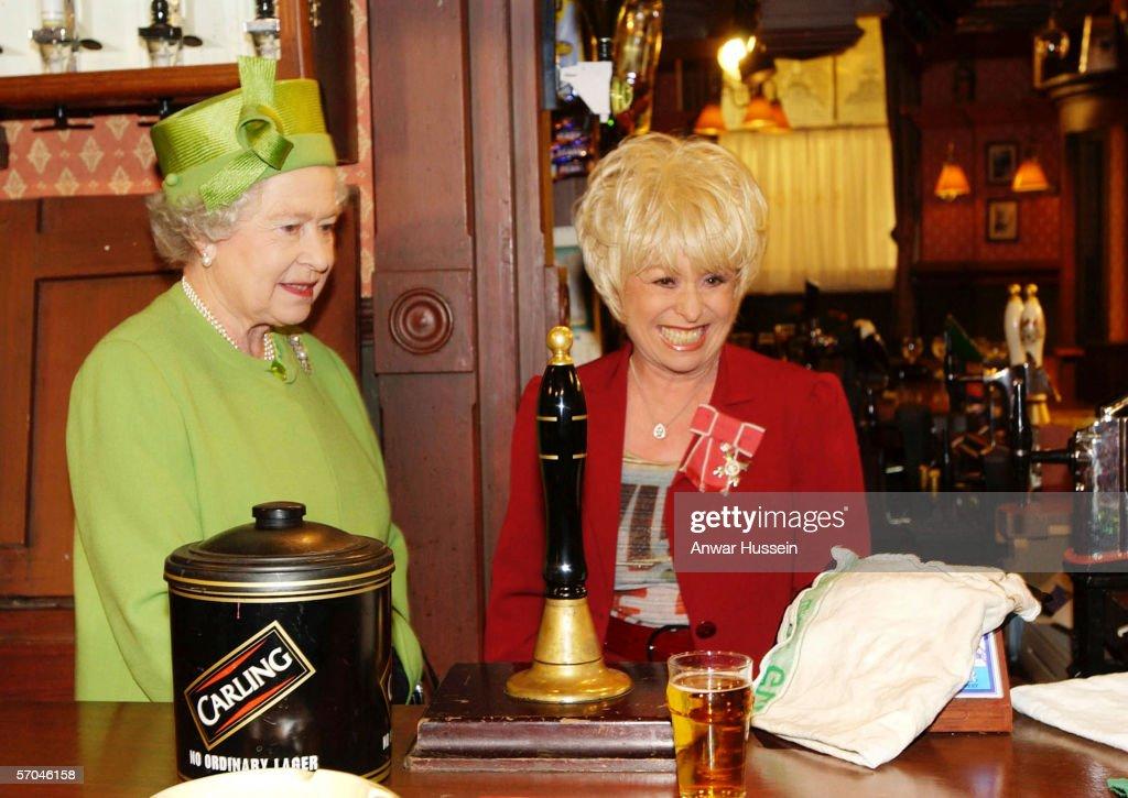 Queen Elizabeth ll visits Eastenders Set : News Photo