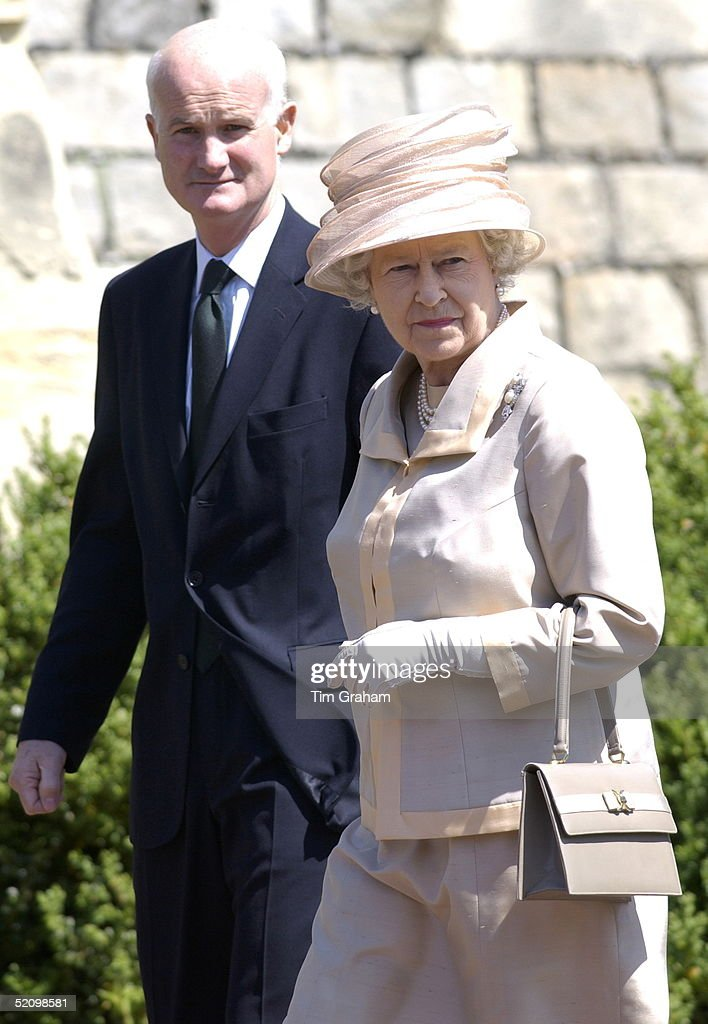 Queen Elizabeth Ll Walking With Sir Michael Peat, The Keeper Of Her Majesty's Privy Purse (the Queen's Finance Director).