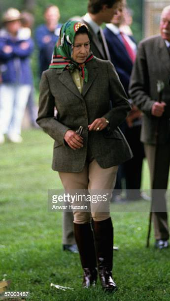 Queen Elizabeth ll walks in riding gear as she visits the Royal Windsor Horse Show in May 1988 in Windsor England