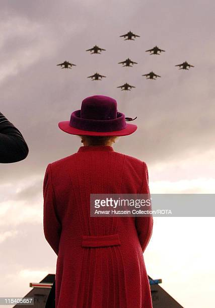 Queen Elizabeth ll watches a flypast of RAF Jagaurs in a diamond 9 formation at RAF Coltishall for its 65th birthday on November 17 2005 The base...