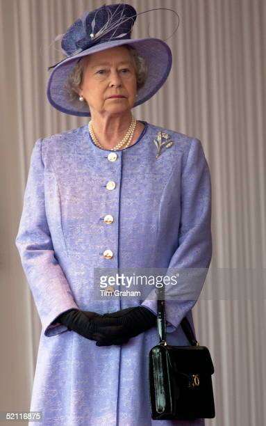 Queen Elizabeth Ll Watches The Official Welcoming Ceremony For The American President State Visit Wearing A Mauve Coat With Matching Hat With Black...