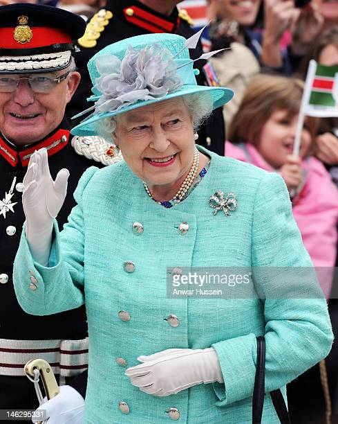 Queen Elizabeth ll waves to the public in the Market Square during a Diamond Jubilee visit to Nottingham on June 13 2012 in Nottingham England
