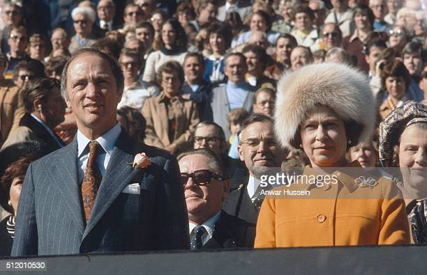 Queen Elizabeth ll wearing a fur hat to keep out the cold and Canadian Prime Minister Pierre Trudeau attend an event on October 15 1977 in Ottawa...
