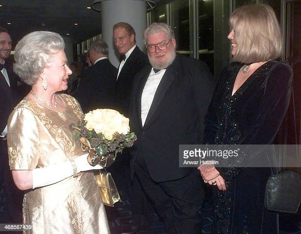 Queen Elizabeth ll wearing a gold dress for the occasion meets Charles Dance Richard Griffiths and Diana Rigg as she arrives at the Festival Hall for...