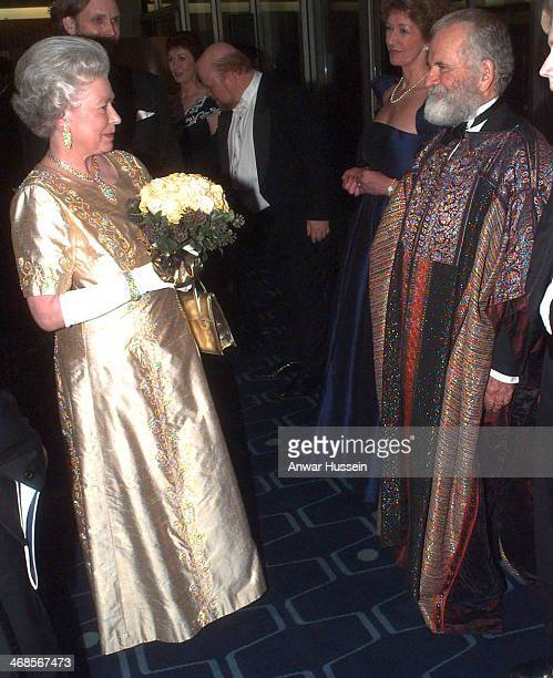 Queen Elizabeth ll wearing a gold dress for the occasion meets Ian Holm as she arrives at the Festival Hall for a Royal Gala to celebrate her Golden...