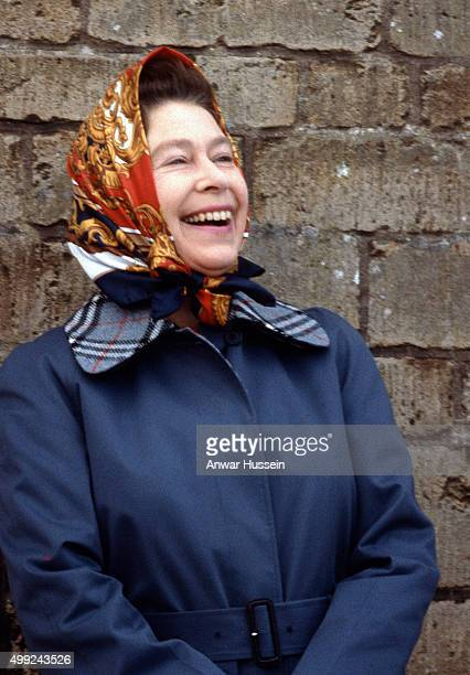 Queen Elizabeth ll wearing a headscarf laughs during Badminton Horse Trials on April 01 1979 in Badminton England