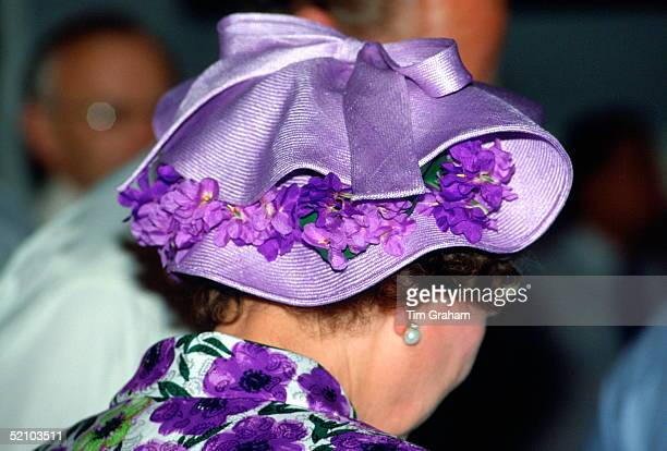Queen Elizabeth Ll Wearing A Mauve Straw Hat Decorated With Violets Designed By Milliner Philip Somerville During Her Official Tour Of Singapore