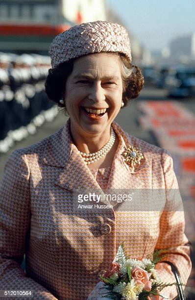 Queen Elizabeth ll wearing a pillbox style hat laughs as she arrives in Casablanca on October 27 1980 in Casablanca Morocco