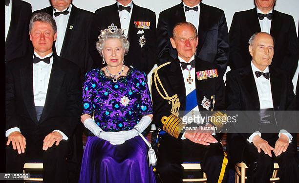 Queen Elizabeth ll wearing the garter star and Prince Phillip the Duke of Edinburgh sit with US President Bill Clinton and French President Francois...