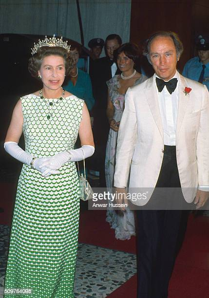 Queen Elizabeth ll wearing the tiara known as 'Granny's Tiara' and Canadian Prime Minister Pierre Trudeau attend a formal event on August 01 1976 in...