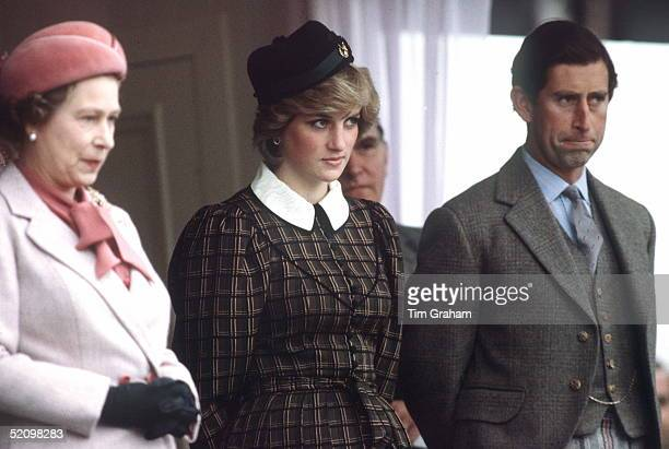 Queen Elizabeth Ll With Princess Diana And Prince Charles Watching The Traditional Highland Games At Braemar