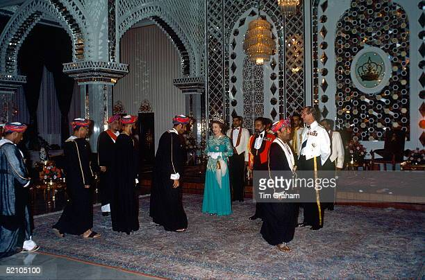 Queen Elizabeth Ll With Sultan Qaboos And Prince Philip Attending A Dinner At The Muscat Palace