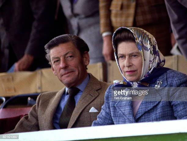 Queen Elizabeth Ll With The Honourable Angus Ogilvy Watching Competitors At The Royal Windsor Horse Show