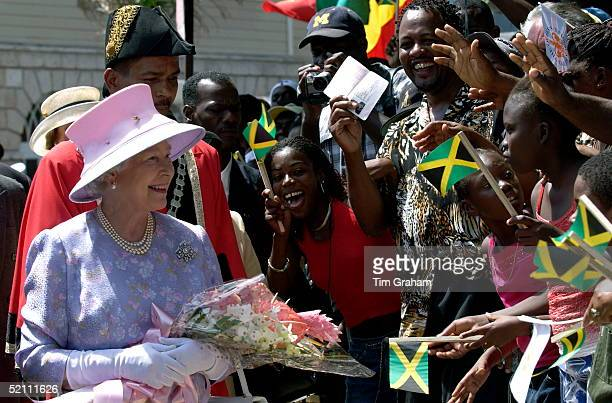 Queen Elizabeth Ll With The Mayor Of Montego Bay Smiling As She Meets An Enthusiastic Crowd That Has Gathered To Greet Her In Sam Sharpe Square Where...