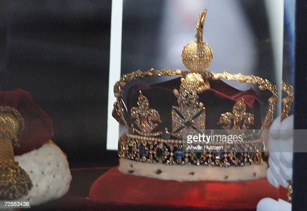 Queen Elizabeth ll's crown is transported from Buckingham Palace to the House of Lords for the State Opening of Parliament on November 15, 2006 in...