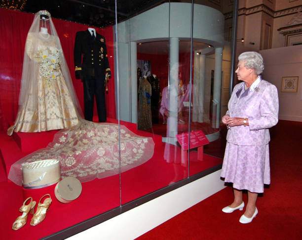 The Queen Looking at Her Wedding Dress Photos and Images | Getty Images