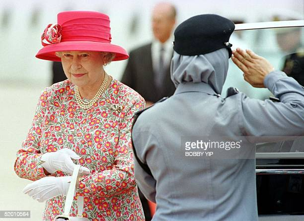 Queen Elizabeth of Great Britain leaves her car at Brunei International Airport in the capital of Bandar Seri Begawan before departing for Malaysia...
