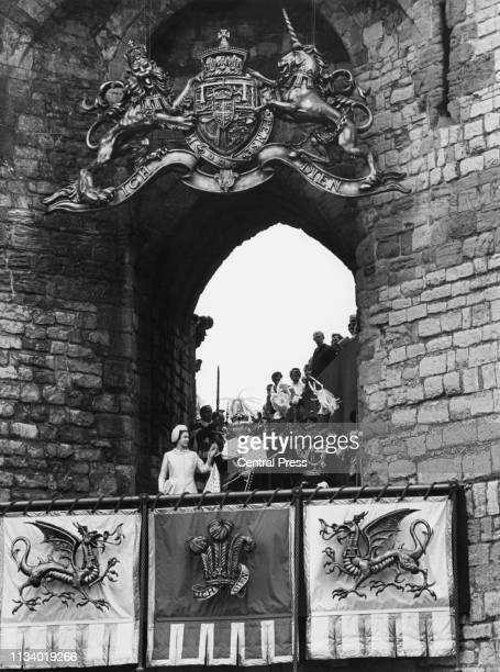 Queen Elizabeth presents the Prince of Wales to the Welsh people on a balcony in front of Queen Eleanor's Gate after his investiture at Caernarfon...