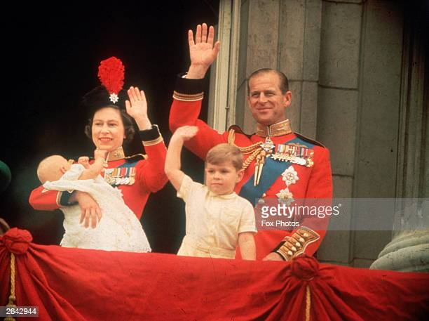 Queen Elizabeth Prince Philip Prince Andrew and Prince Edward waving to the crowds from the balcony at Buckingham Palace during the Trooping of the...
