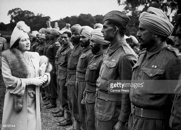 Queen Elizabeth Queen Consort to King George VI visiting soldiers released from German prisonerofwar camps and resting in Britain on their way home...