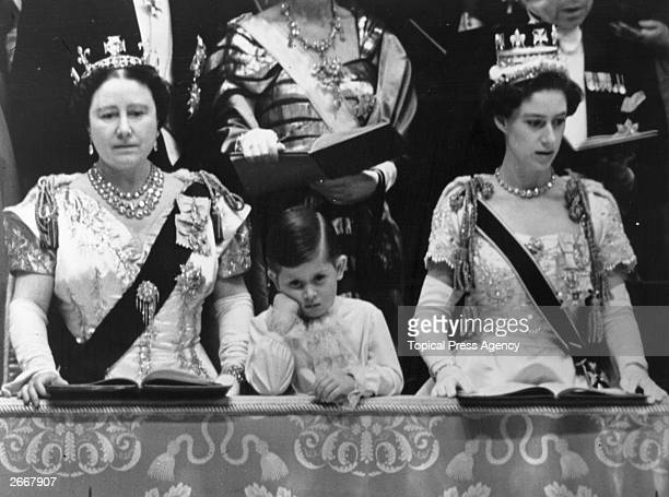 Queen Elizabeth Queen Mother and Prince Charles with Princess Margaret Rose in the royal box at Westminster Abbey watching the Coronation ceremony of...