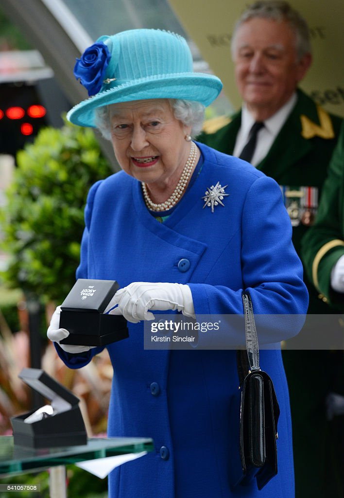 Queen Elizabeth receives her prize after Dartmouth won the Hardwicke Stakes on day 5 of Royal Ascot at Ascot Racecourse on June 18, 2016 in Ascot, England.