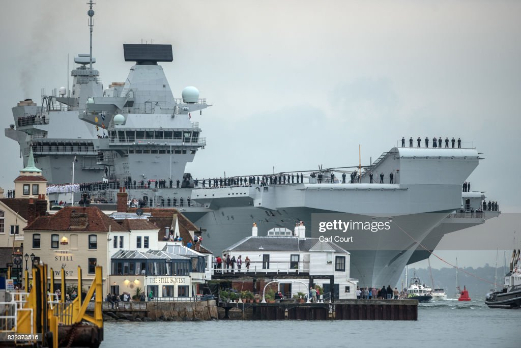 HMS Queen Elizabeth sails into her home port of Portsmouth Naval Base on August 16, 2017 in Portsmouth, England. HMS Queen Elizabeth is the lead ship in the new Queen Elizabeth class of supercarriers. Weighing in at 65,000 tonnes she is the largest warship deployed by the British Royal Navy. She is planned to be in service by 2020 and with a second ship, HMS Prince of Wales, to follow.