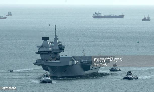 Queen Elizabeth sails into her home port of Portsmouth Naval Base following sea trials and ahead of being formally commissioned into the Royal Navy...