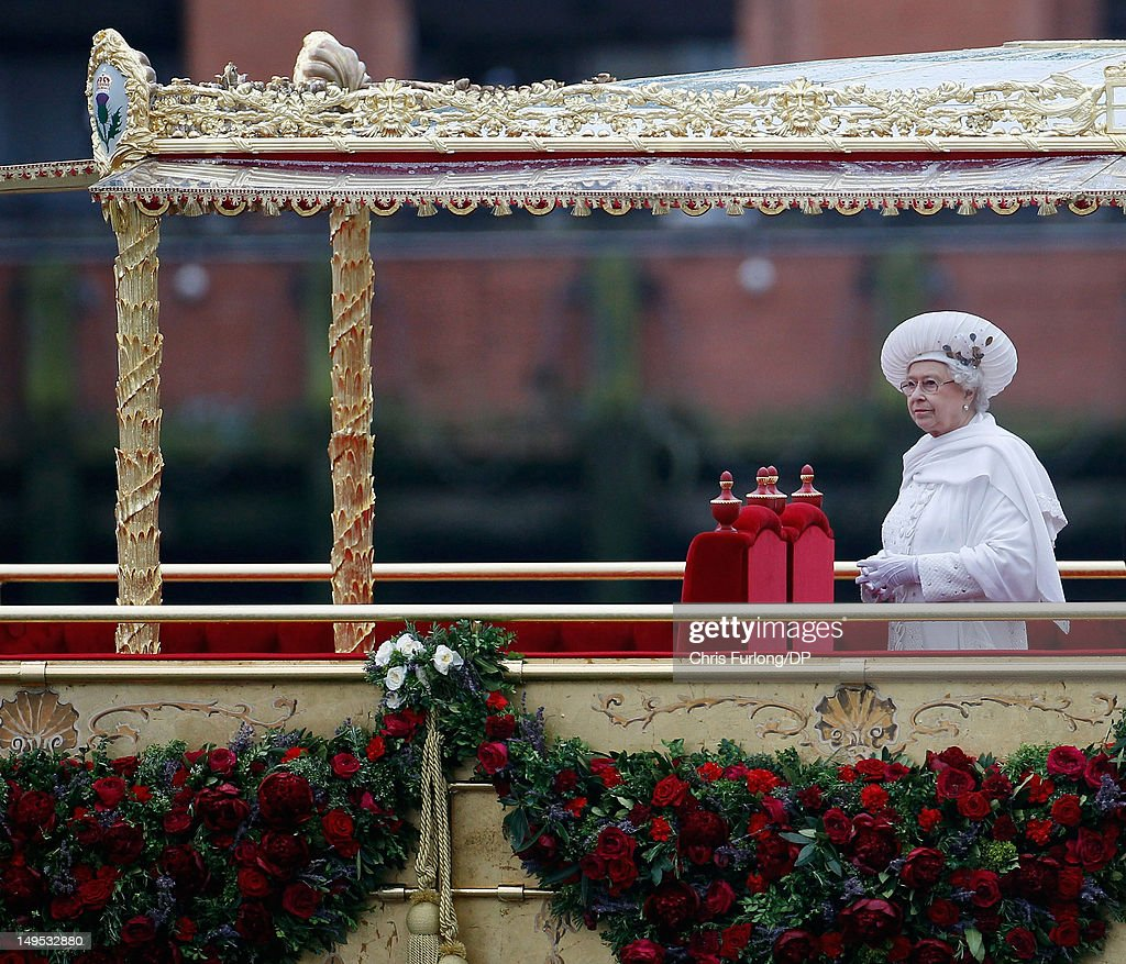 Queen Elizabeth sails on the royal barge 'The Spirit of Chartwell' during the Thames Diamond Jubilee River Pageant during the Thames Diamond Jubilee River Pageant on June 3, 2012 in London, England. For only the second time in its history the UK celebrates the Diamond Jubilee of a monarch. Her Majesty Queen Elizabeth II celebrates the 60th anniversary of her ascension to the throne. Thousands of well-wishers from around the world have flocked to London to witness the spectacle of the weekend's celebrations. The Queen along with all members of the royal family will participate in a River Pageant with a flotilla of a 1,000 boats accompanying them down The Thames.
