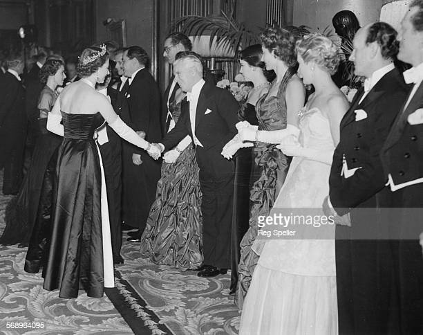 Queen Elizabeth shaking hands with actor Charlie Chaplin during a line up after the Royal Film Performance at the Empire, Leicester Square, London,...