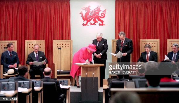 Queen Elizabeth signs a special edition of the 'first words' Act before presenting the bound volume to the Welsh Assembly and it's Members 26 May...