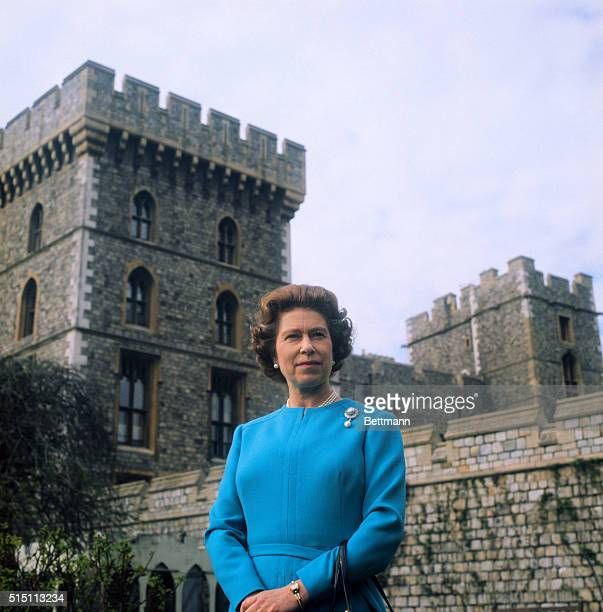 Queen Elizabeth smiles as she poses for official pictures in courtyard of Windsor Castle. The monarch celebrates her 50th birthday 4/21/76.