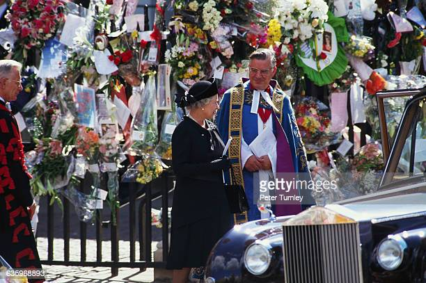 Queen Elizabeth stands with a priest at the funeral of Diana Princess of Wales only seven days after she was killed in an automobile accident in...