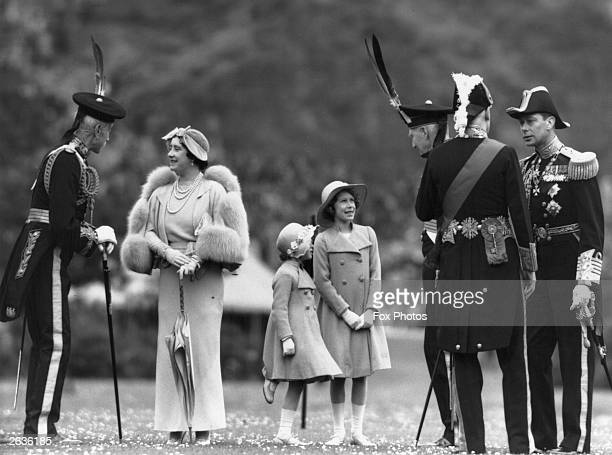 Queen Elizabeth talking to Lord Elphinstone during an inspection of the Royal Company of Archers at the Palace of Holyroodhouse, Edinburgh. Her...