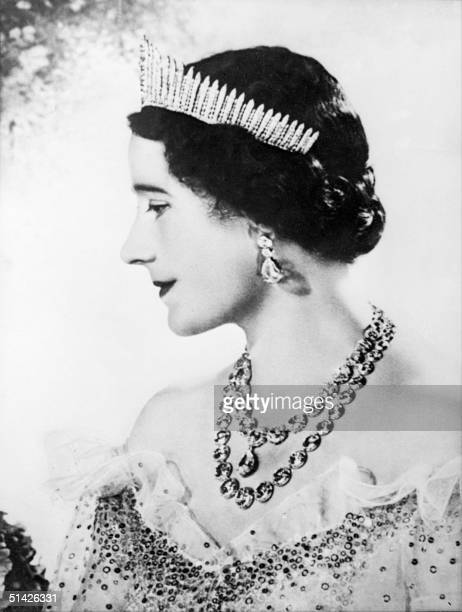 Queen Elizabeth the former Duchess of York smiles as she poses in 1937 for official picture in London after the Coronation 12 May 1937 of the Duke of...