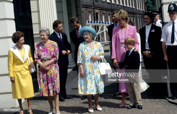 Queen Elizabeth the Queen Mother, accompanied by Princess Margaret, Queen Elizabeth ll, Diana, Princess of Wales and Prince Harry, greets the public...