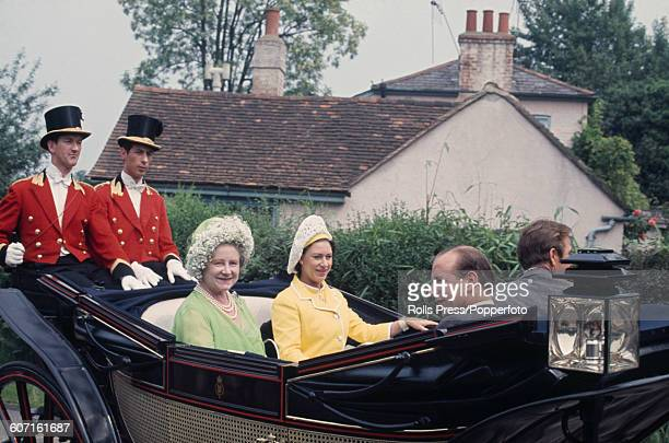 Queen Elizabeth the Queen Mother and Princess Margaret Countess of Snowdon ride together in a royal carriage to Ascot Racecourse during Royal Ascot...