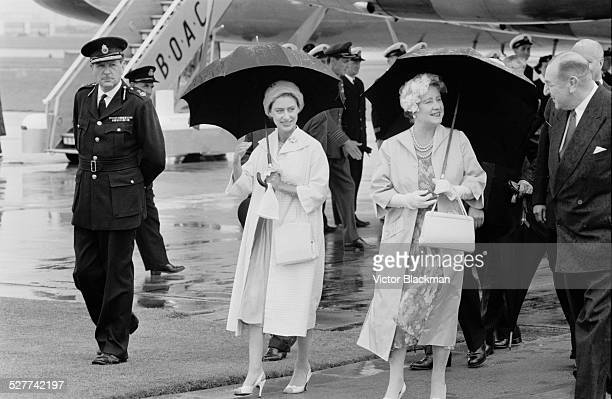 Queen Elizabeth The Queen Mother at London Airport for the arrival of Princess Margaret Countess of Snowdon after her Canadian tour 12th August 1958