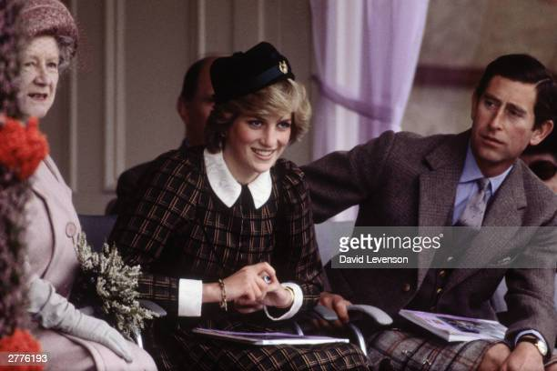 Queen Elizabeth the Queen Mother Diana Princess of Wales and Prince Charles watch the Braemar Games on September 4 1982 at Braemar near Balmoral...