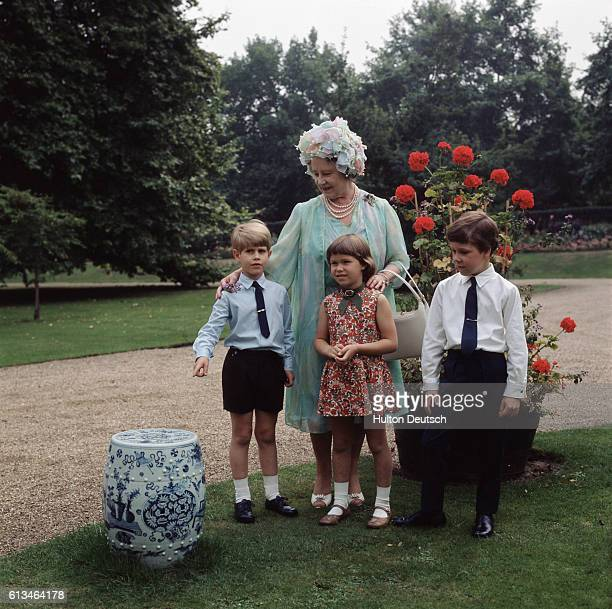 Queen Elizabeth the Queen Mother on the occasion of her 70th birthday with her grandchildren Prince Edward Lady Sarah ArmstrongJones and David...