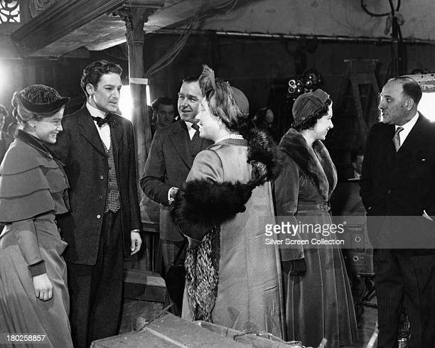 Queen Elizabeth the Queen Mother talking to English actor Robert Donat during a visit to the set of 'The Magic Box' at Elstree Studios Hertfordshire...