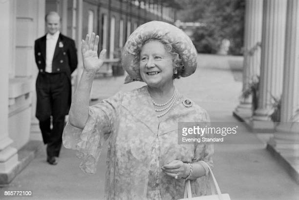 Queen Elizabeth, the Queen Mother , waves to the crowd who have gathered outside Clarence House, her London home, to wish her a happy 78th birthday,...