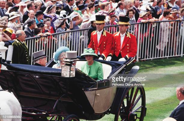 Queen Elizabeth The Queen Mother wearing a blue and yellow floral print outfit with a blue hat and Diana Princess of Wales wearing a green outfit...