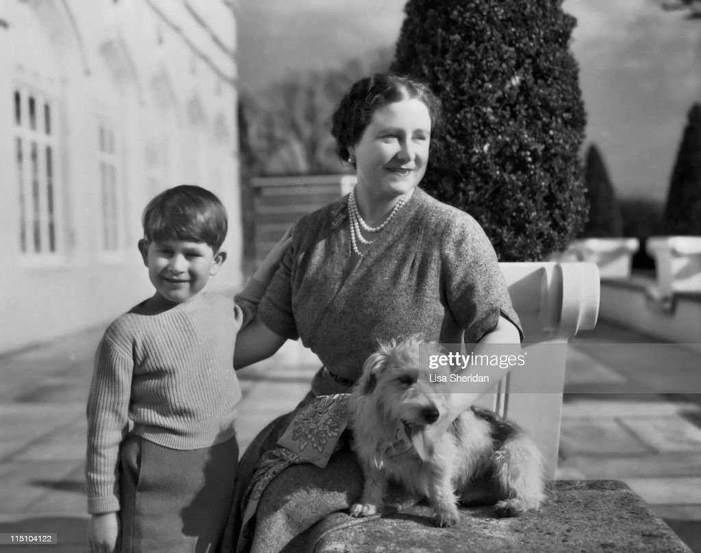Queen Elizabeth The Queen Mother (1900 - 2002) with her grandson Prince Charles on the patio of the Royal Lodge in Windsor, England on April 07, 1954.